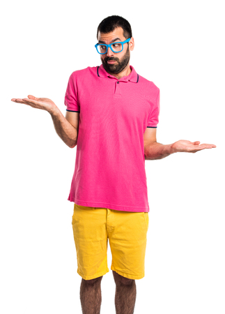 unimportant: Man with colorful clothes making unimportant gesture Stock Photo