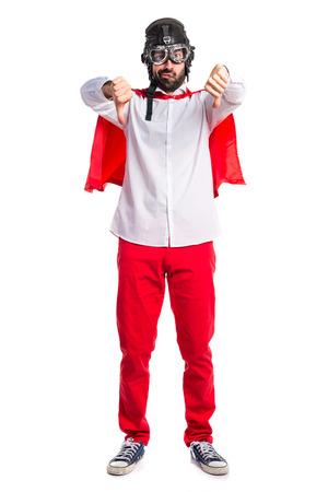 disapprove: Crazy superhero man doing bad signal Stock Photo