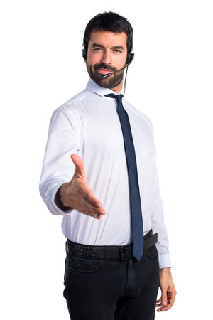 Handsome telemarketer man making a deal Stock Photo