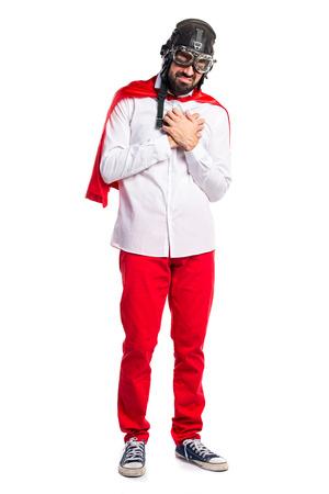 Crazy superhero man with heart pain Banco de Imagens