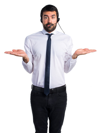 unimportant: Young man with a headset making unimportant gesture
