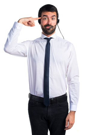 Young man with a headset making crazy gesture