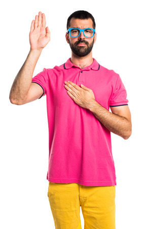 an oath: Man with colorful clothes doing an oath Stock Photo