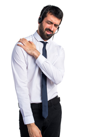 Young man with a headset with shoulder pain Stock Photo