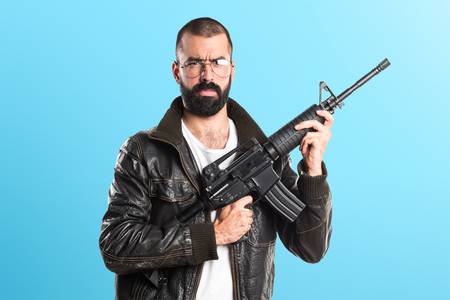pimp: Pimp man holding a rifle Stock Photo