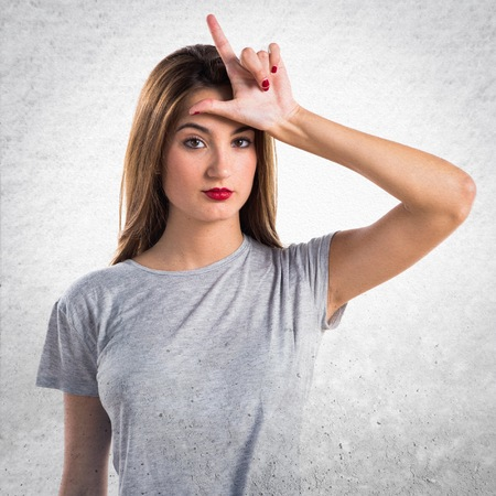 blonde hispanic: Girl doing stupid gesture