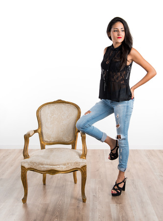 Pretty girl with vintage armchair