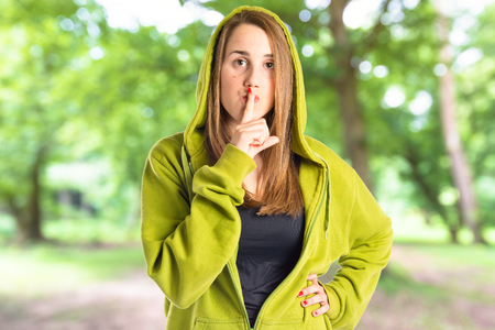 Young girl making silence gesture over isolated white background Stock Photo