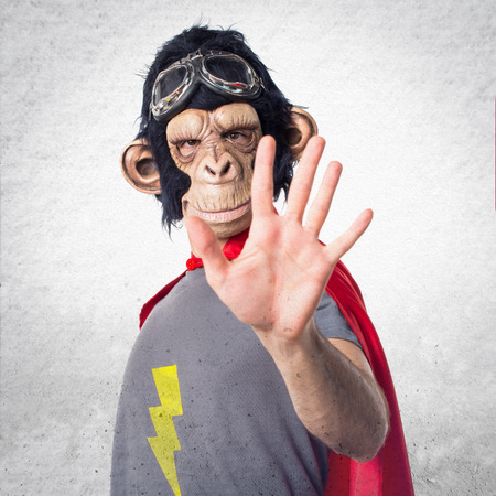 counting five: Superhero monkey man counting five Stock Photo
