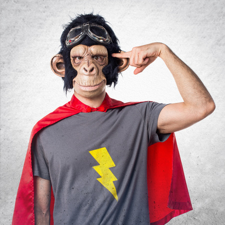Superhero monkey man making crazy gesture Stock Photo