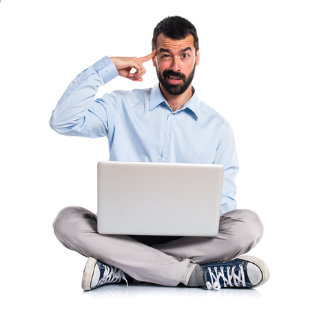 Man with laptop making crazy gesture