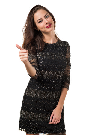 Pretty young girl with thumb up Stock Photo