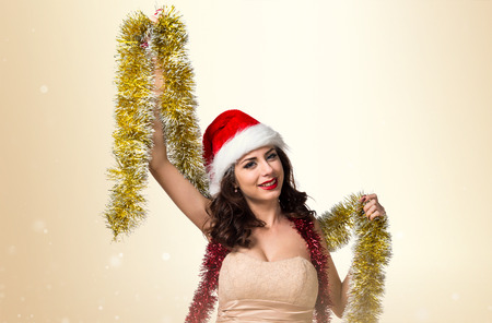 Pretty young woman with christmas wreaths