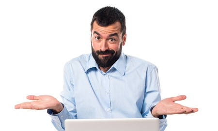 unimportant: Man with laptop making unimportant gesture