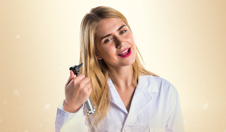 otorhinolaryngologist: Doctor woman with otoscope Stock Photo