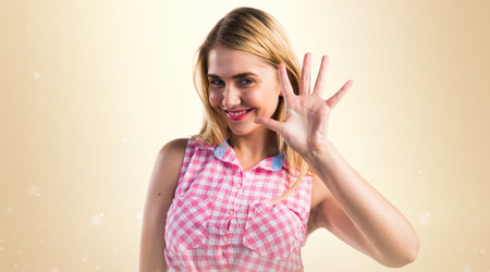 counting five: Blonde girl counting five Stock Photo