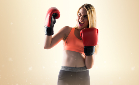 Lucky girl with boxing gloves Stock Photo