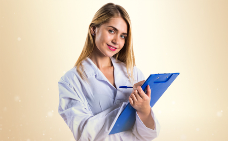 holding notes: Doctor woman holding notes Stock Photo
