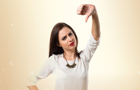 disapprove: Pretty young girl making bad signal Stock Photo
