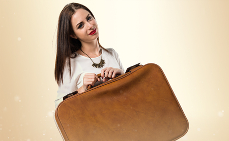 Pretty young girl holding a vintage briefcase