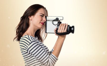 filmmaker: Pretty young girl filming
