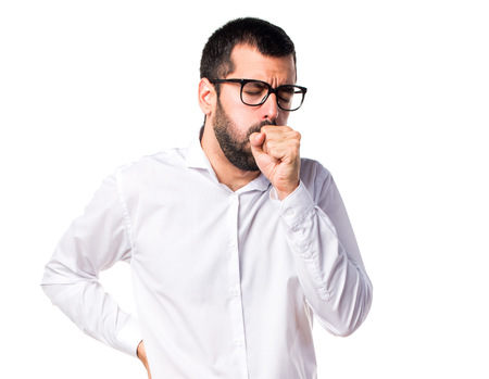 Handsome man with glasses coughing a lot Stock Photo - 67880652
