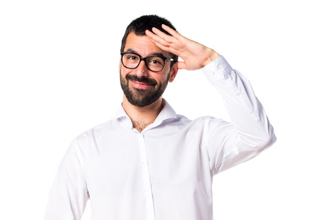 Handsome man with glasses saluting