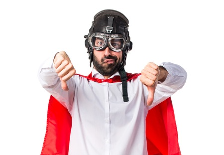 Crazy superhero man doing bad signal Stock Photo