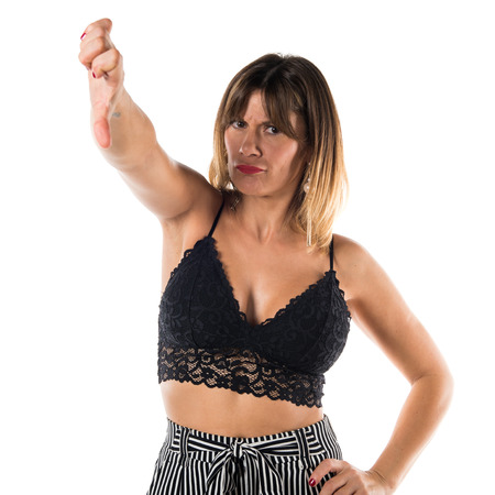 disapprove: Pretty woman making bad signal