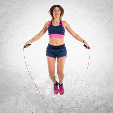 Sport woman jumping rope Stock Photo