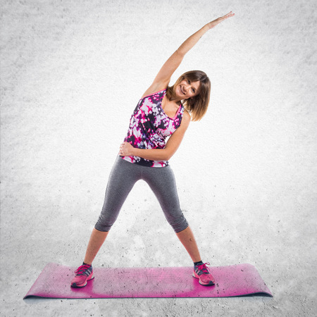 Sport woman stretching on mat