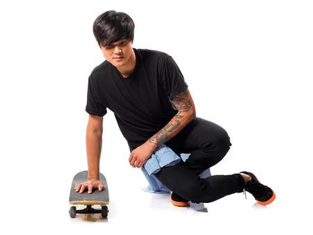 Asian urban man with skate