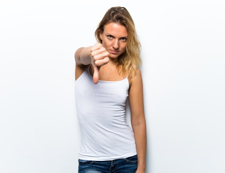 disapprove: Pretty young woman making bad signal