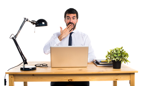mistakes: Businessman in his office doing surprise gesture