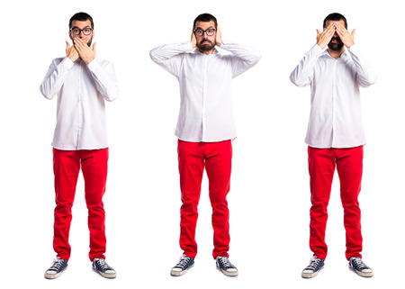 ignore: Handsome man with glasses covering his ears Stock Photo