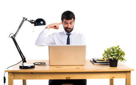 Businessman in his office making crazy gesture Stock Photo