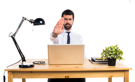 Businessman in his office making stop sign Stock Photo