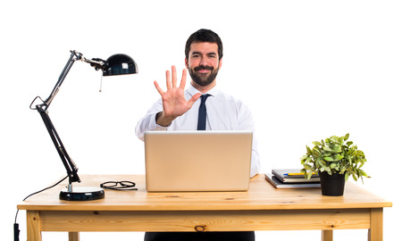 counting five: Businessman in his office counting five Stock Photo