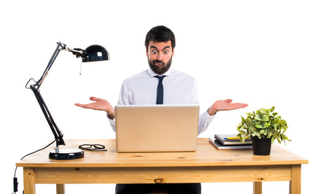 unimportant: Businessman in his office making unimportant gesture Stock Photo