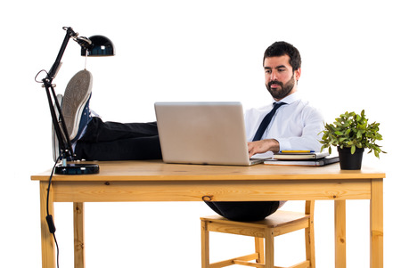Businessman working with laptot in his office Stock Photo