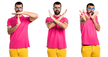 Man with colorful clothes doing NO gesture
