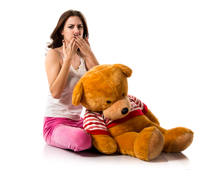 Pretty brunette girl with pajamas covering his mouth Stock Photo