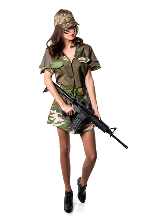 Military woman holding a rifle