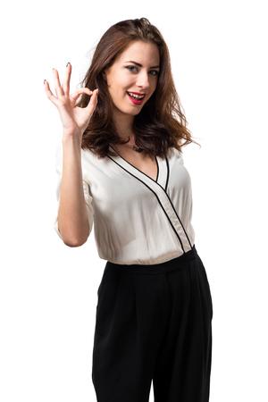 Beautiful brunette girl making OK sign