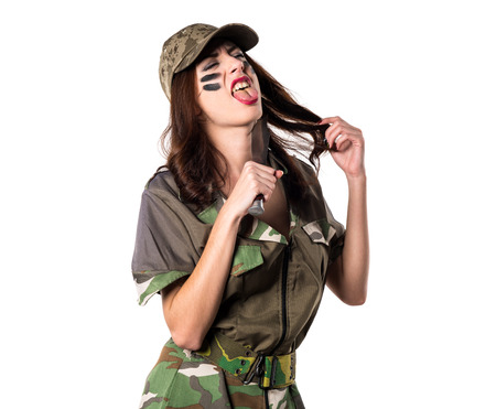 Military girl holding a knife and cometing suicide