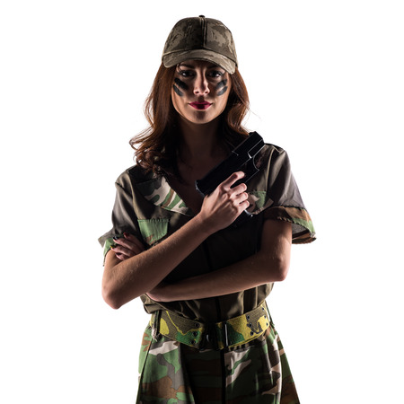 Military girl holding a pistol
