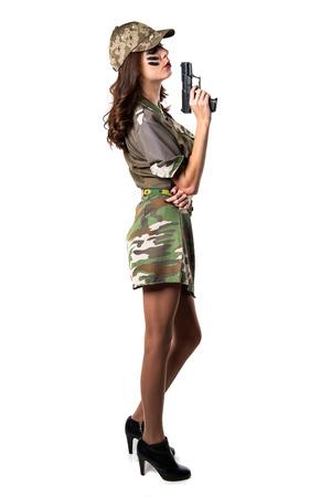 Military girl holding a pistol