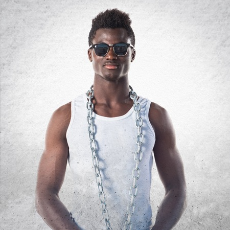 Handsome black man with sunglasses and chains Stock Photo