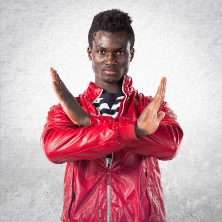 Handsome black man doing NO gesture