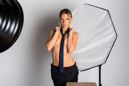 Sexy beauty blonde woman posing in studio